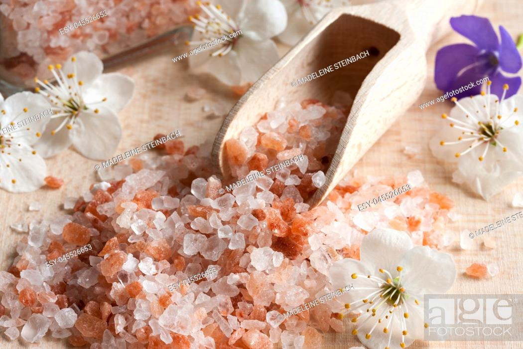 Stock Photo: Pink Himalayan sea salt on a wooden background.