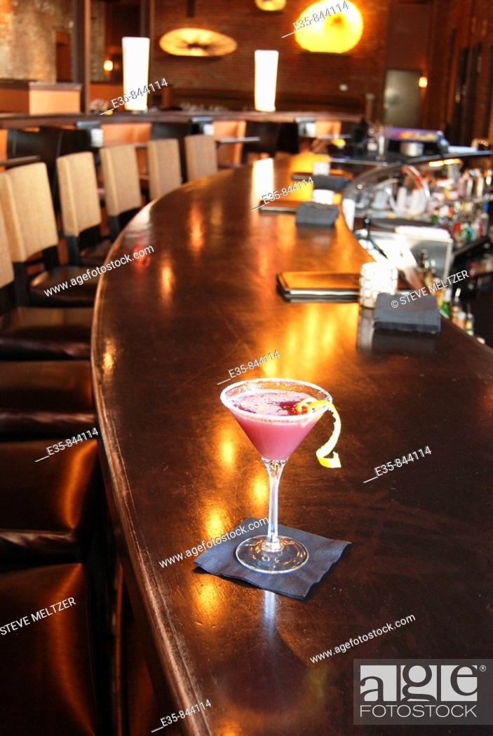Stock Photo: pink margarita, bar drink, bar, specialty drink, alcohol, restaurant, singles bar, lemon twist.
