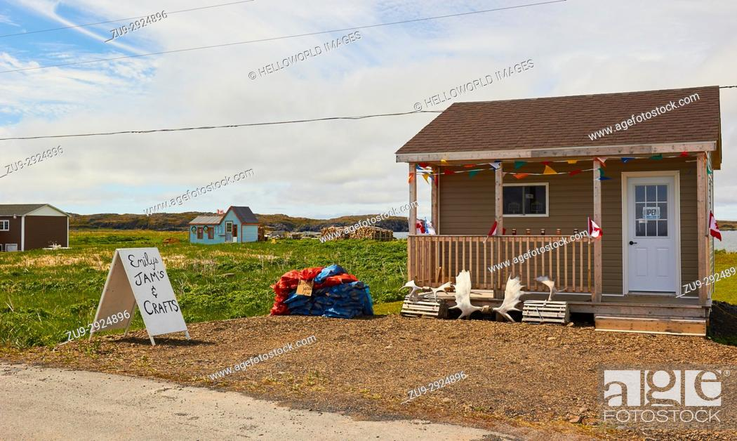 Stock Photo: Jams and firewood displayed for sale in the front yard of a timber house, L'Anse Aux Meadows, Newfoundland, Canada.
