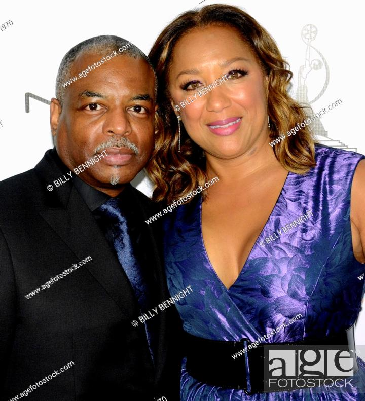 Stock Photo: Actor LeVar Burton and wife Stephanie Cozart Burton attends 2016 Make-up artists and Hair Stylists Guild Awards at Paramount Theatre at Paramount Studios on.