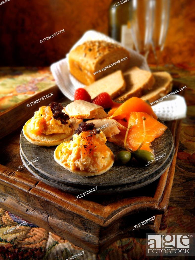 Stock Photo: smoked salmon and scrambled egg on brown bread.