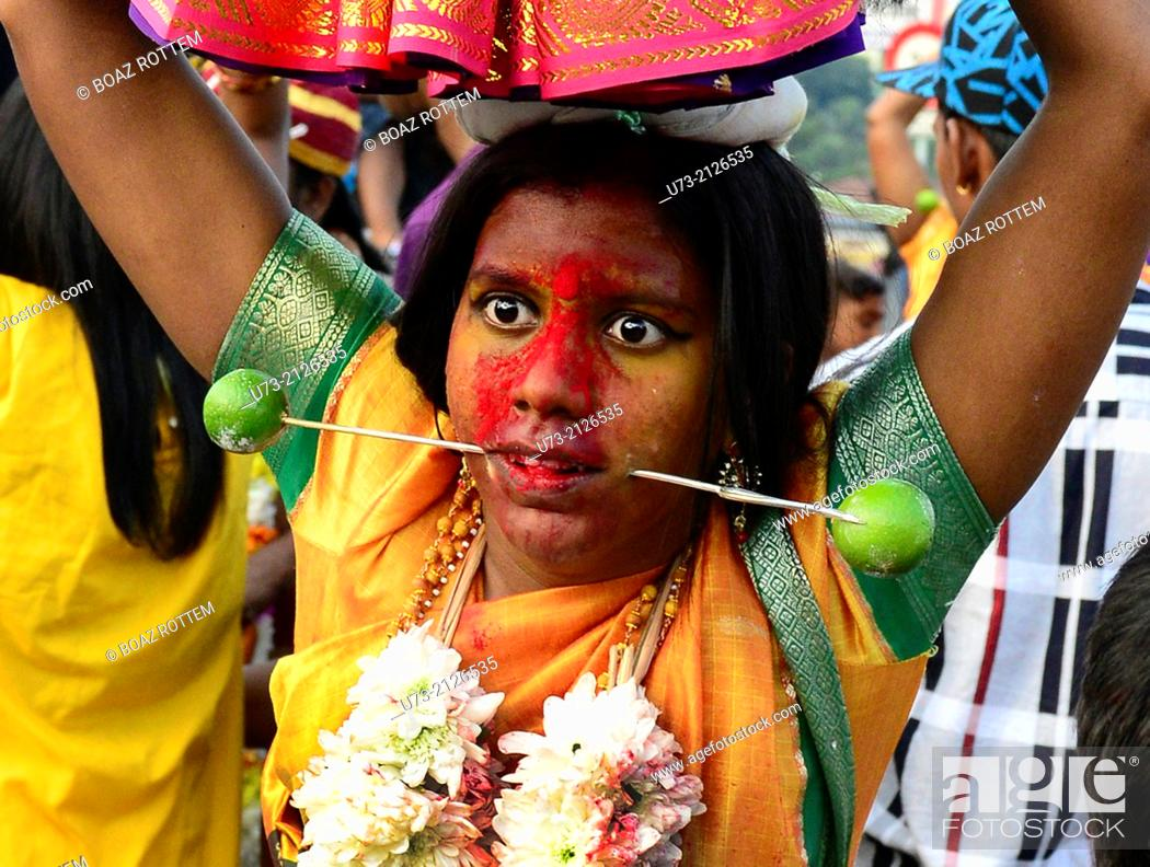 Stock Photo: Bizarre scenes at the annual Hindu Thaipusam festival in KL, Malaysia.
