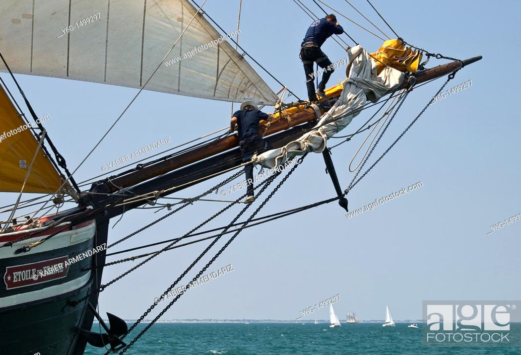 Stock Photo: Working in the bowspirit  French Tall ship Etoile de France, Bay of Morbihan, Brittany, France.