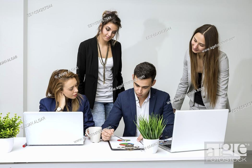 Stock Photo: The group of managers sitting and browsing the diagram in the office. Horizontal indoors shot.