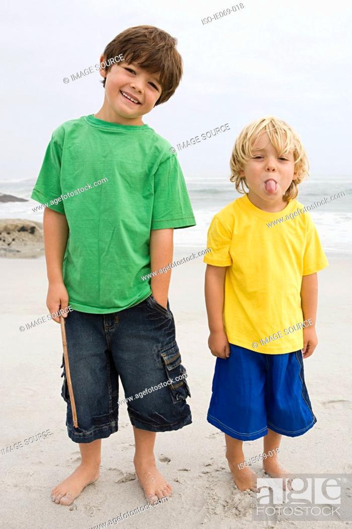 Stock Photo: Two boys on a beach.