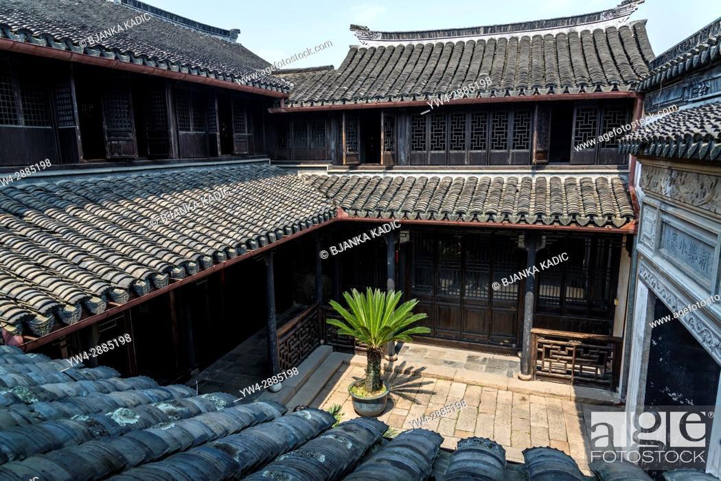 Stock Photo: Atrium with palm tree, Happy Farming Hall, Ancient water town of Tongli, Suzhou, Jiangsu Province, China.
