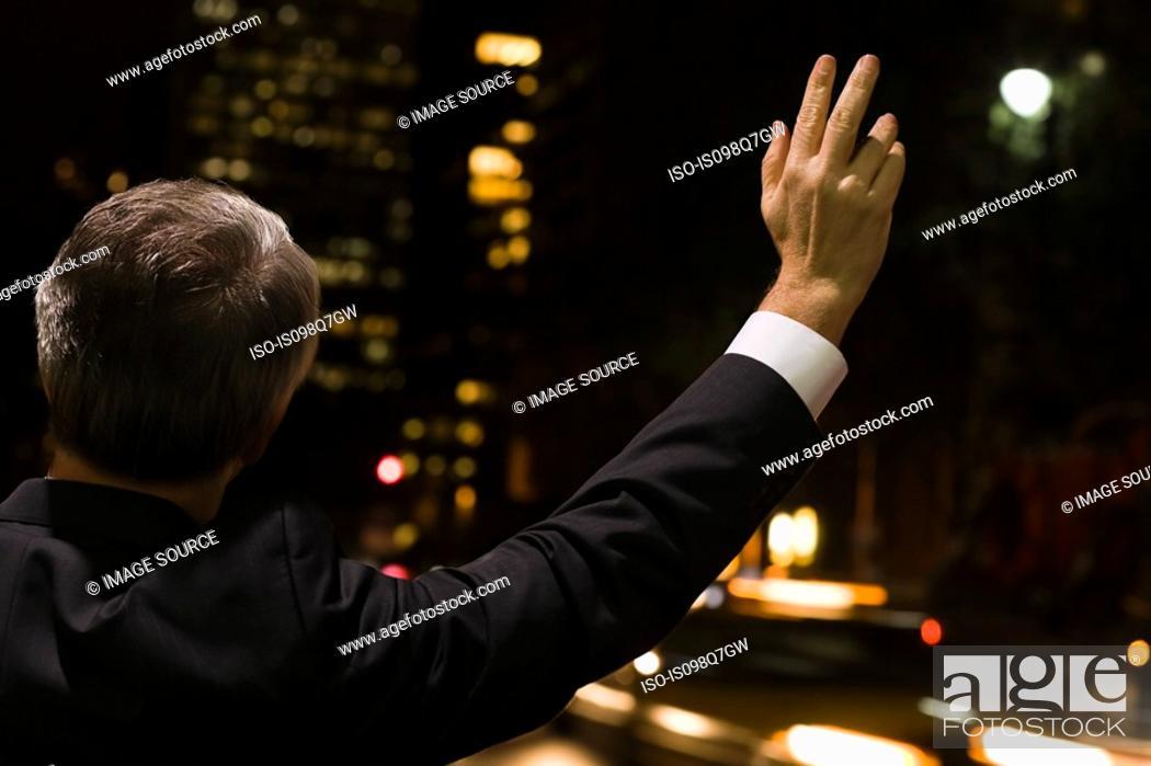 Stock Photo: Businessman hailing a cab.