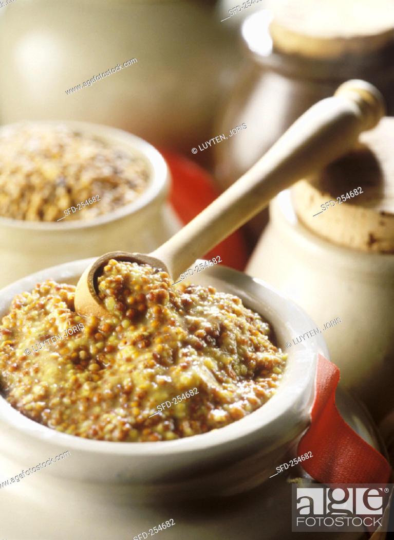 Stock Photo: Grain mustard in a pot.