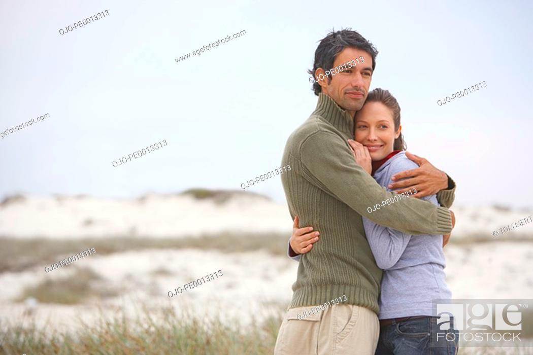 Stock Photo: Man and woman on beach embracing.