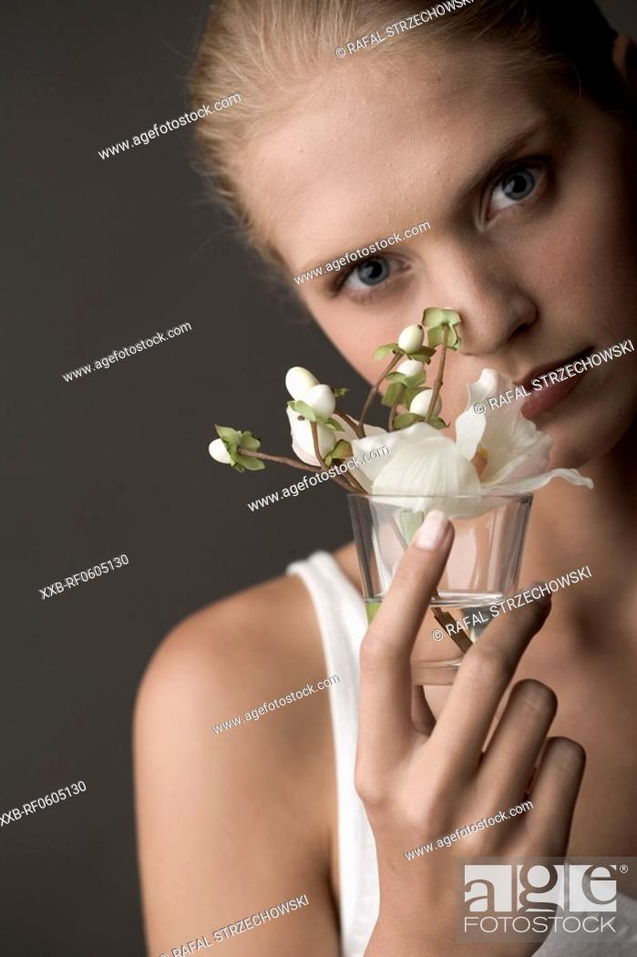 Stock Photo: young woman with lily.