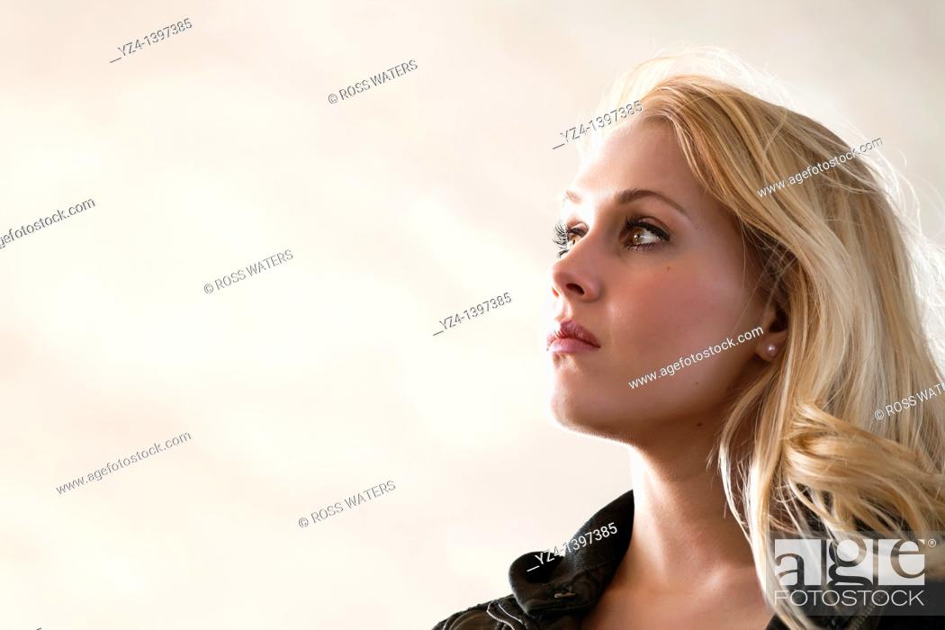 Stock Photo: Profile of a young woman outdoors.