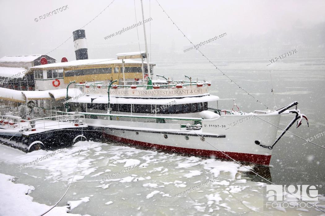 Stock Photo: Floating Restaurant on the Frozen Danube in Budapest Hungary.