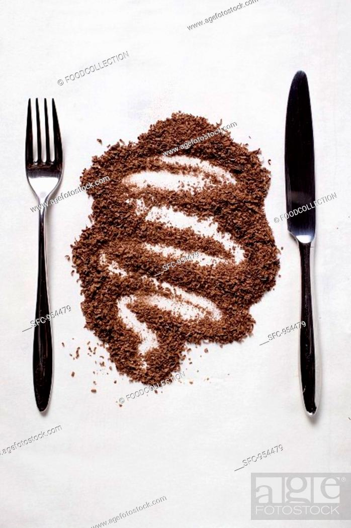 Stock Photo: Grated chocolate between knife and fork.