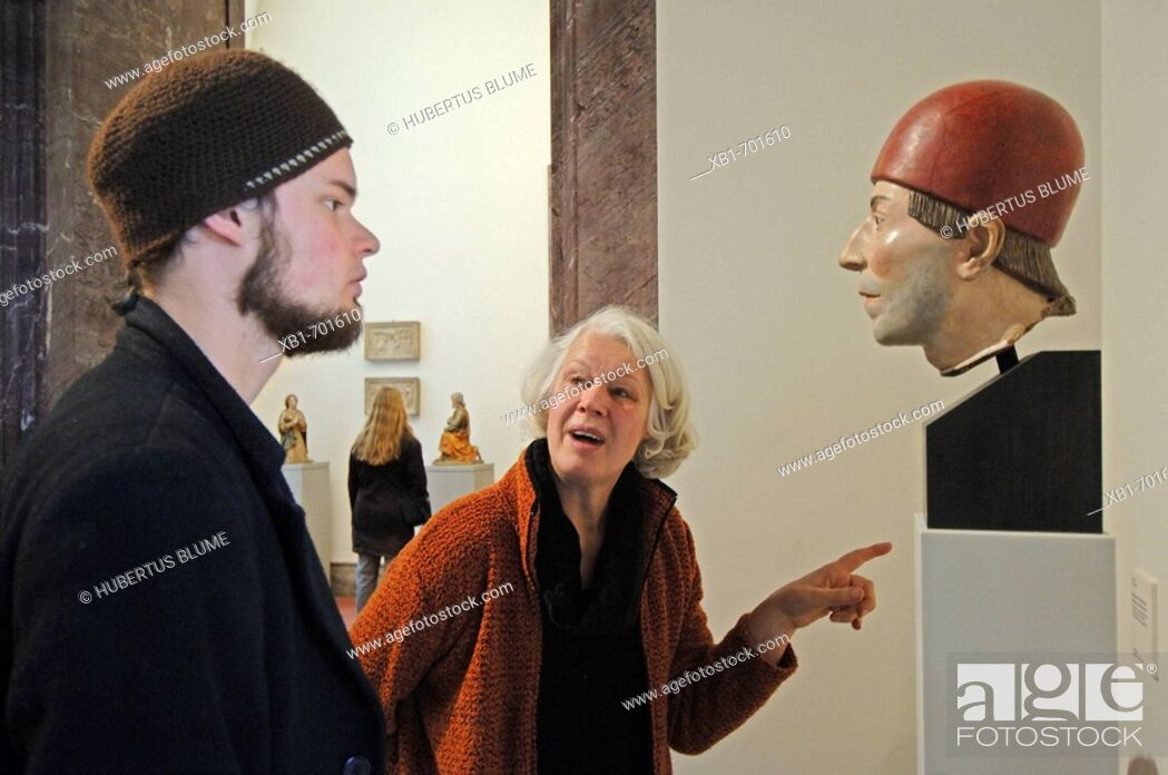 Stock Photo: Visitors looking at a sculpture. Bode Museum, Museum Island, Berlin.