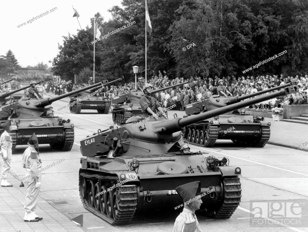 Stock Photo: Tanks drive past the honorary tribune during the parade on the occasion of the French national day on the 14th of July in 1962 in the headquarters Quartier.