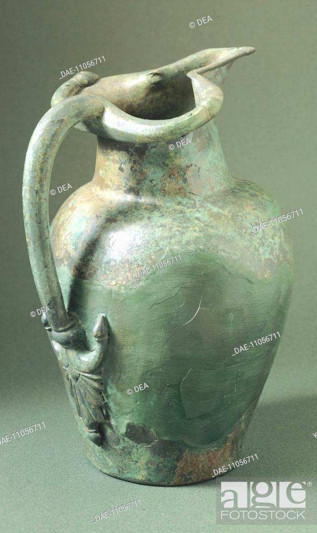 Stock Photo: Bronze oinochoe. Etruscan civilization, 5th Century BC.  Parma, Museo Archeologico Nazionale (Archaeologicla Museum) Palazzo Della Pilotta.