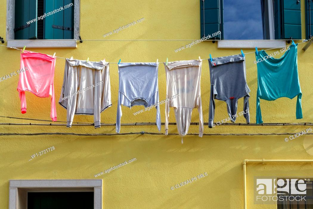 Stock Photo: Europe, Italy, Veneto, Chioggia. Hanging clothes on a old house facade.