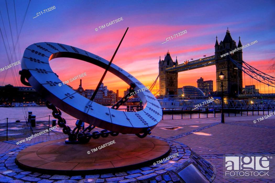 Stock Photo: tower bridge and giant time sundial dusk sunset london england uk europe.