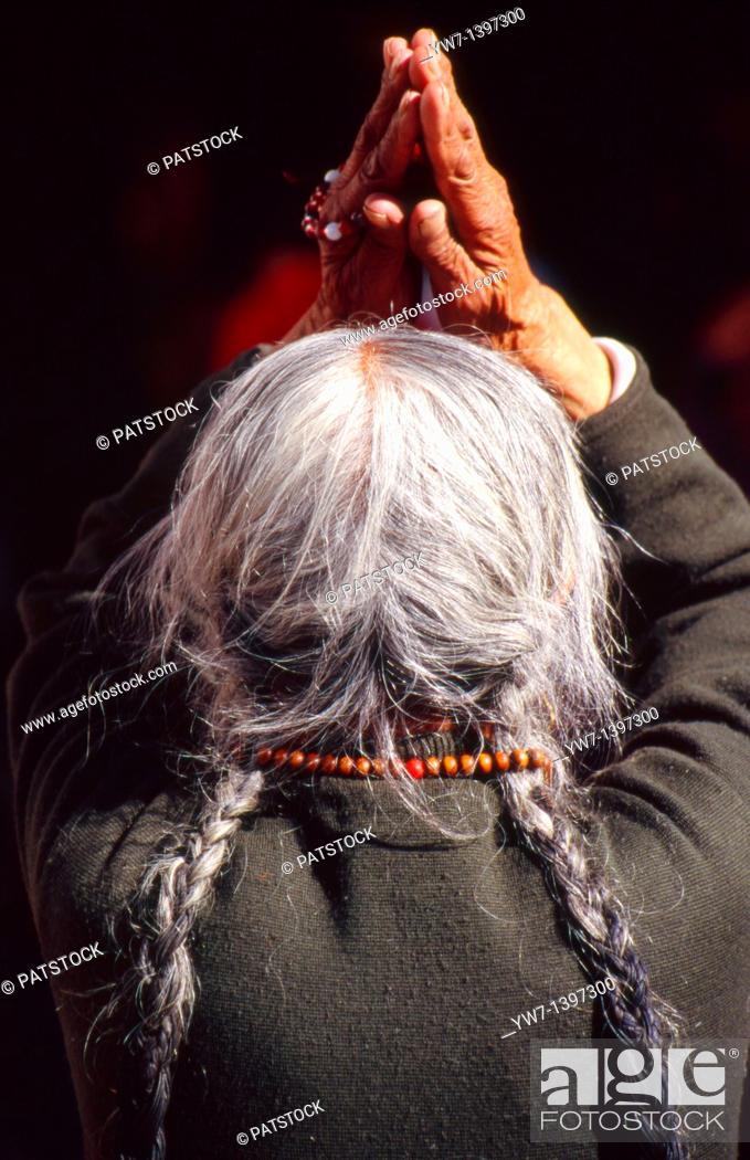 Stock Photo: A Tibetan woman praying in Lhasa, Tibet.