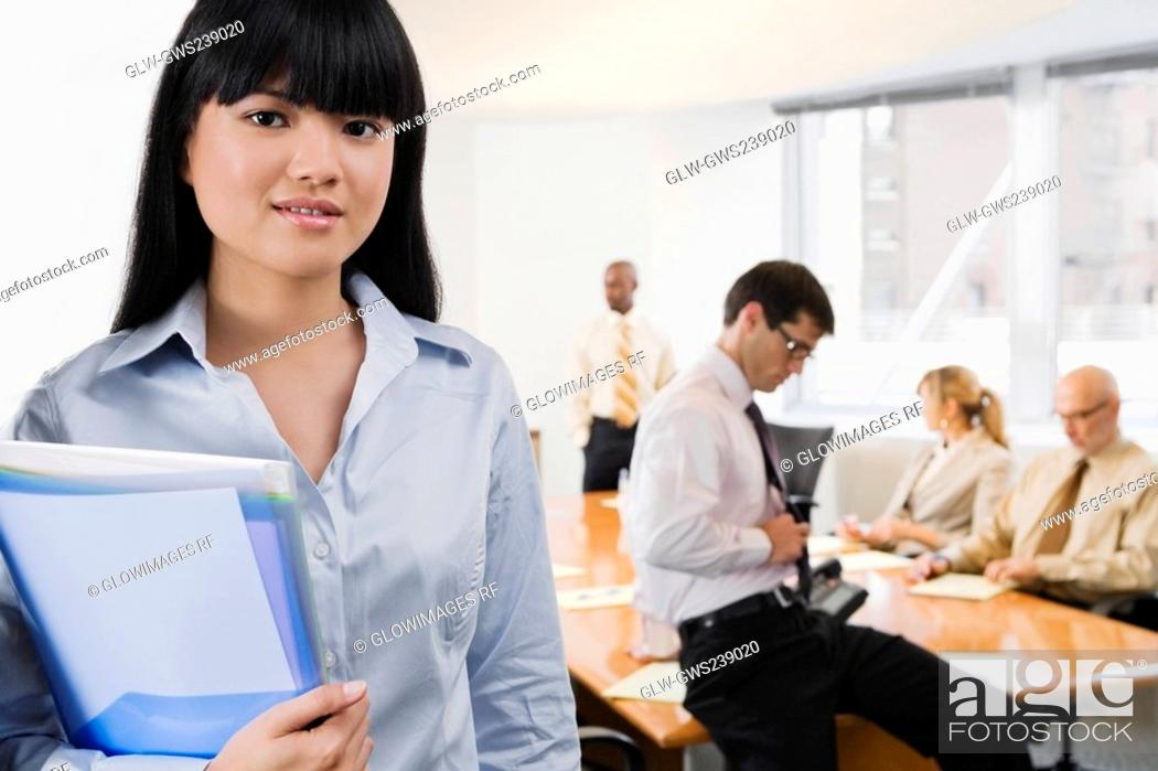 Stock Photo: Portrait of a businesswoman holding files.