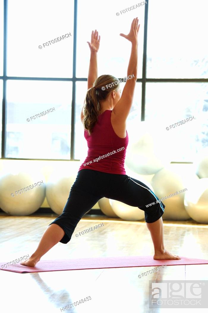 Stock Photo: Caucasian prime adult female doing yoga.