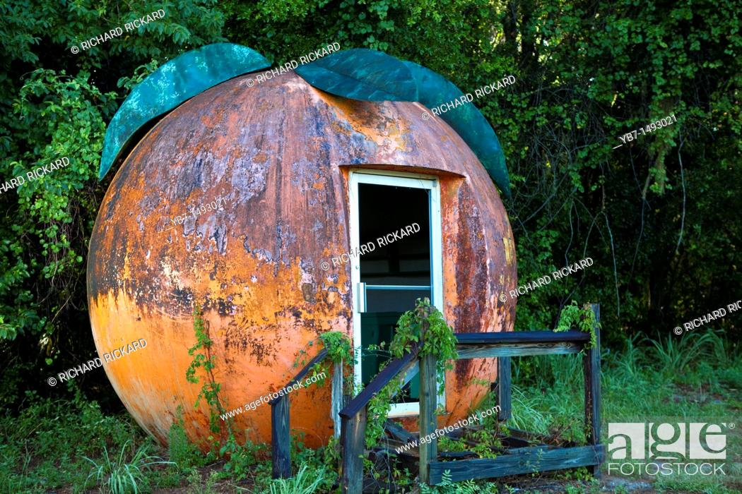 Stock Photo: Old Building shaped as a big Orange, Abandoed  Florida, USA.
