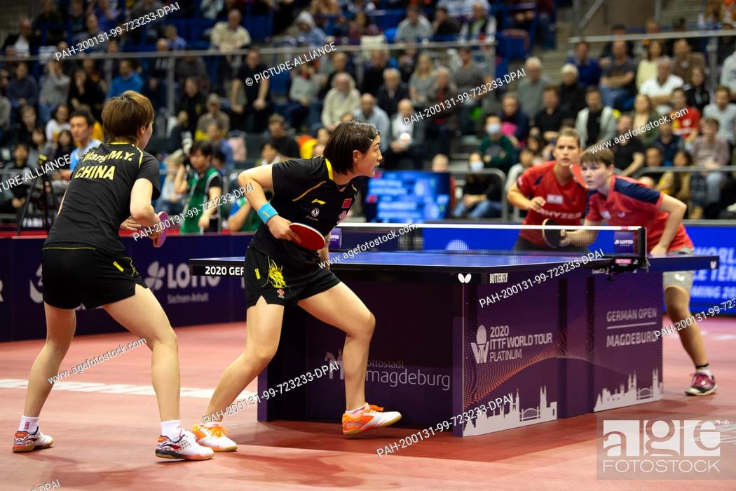 Stock Photo: 31 January 2020, Saxony-Anhalt, Magdeburg: Table tennis: German Open, women, doubles, semi-finals, Solja/Mittelham (Germany) - Chen/Wang (China).