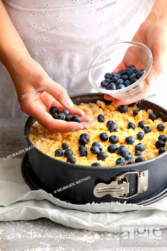 Photo de stock: Blueberry crumble cake being made.