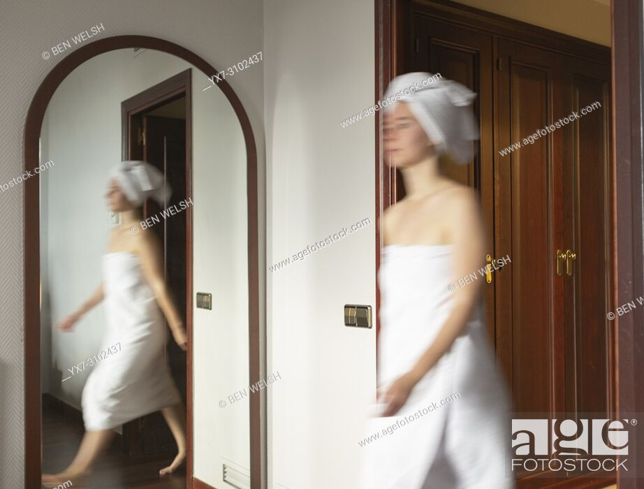 Stock Photo: Young woman in a hotel room. Madrid, Spain, Europe.