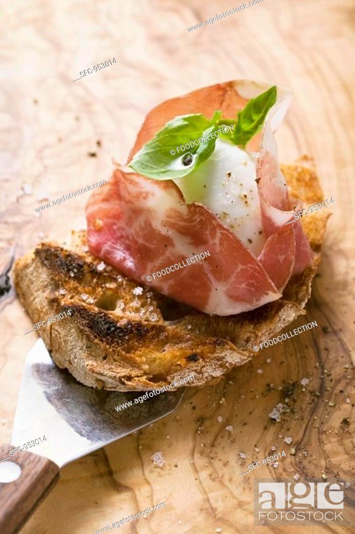 Stock Photo: Crostini with Parma ham, mozzarella and basil.