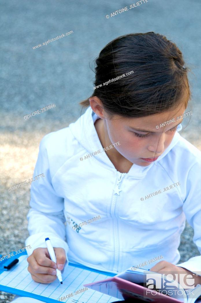 Stock Photo: Little girl outdoor homework.