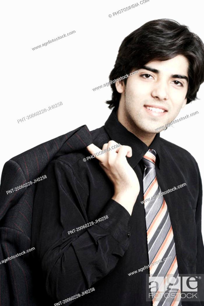 Photo de stock: Portrait of a businessman holding his coat over his shoulder.