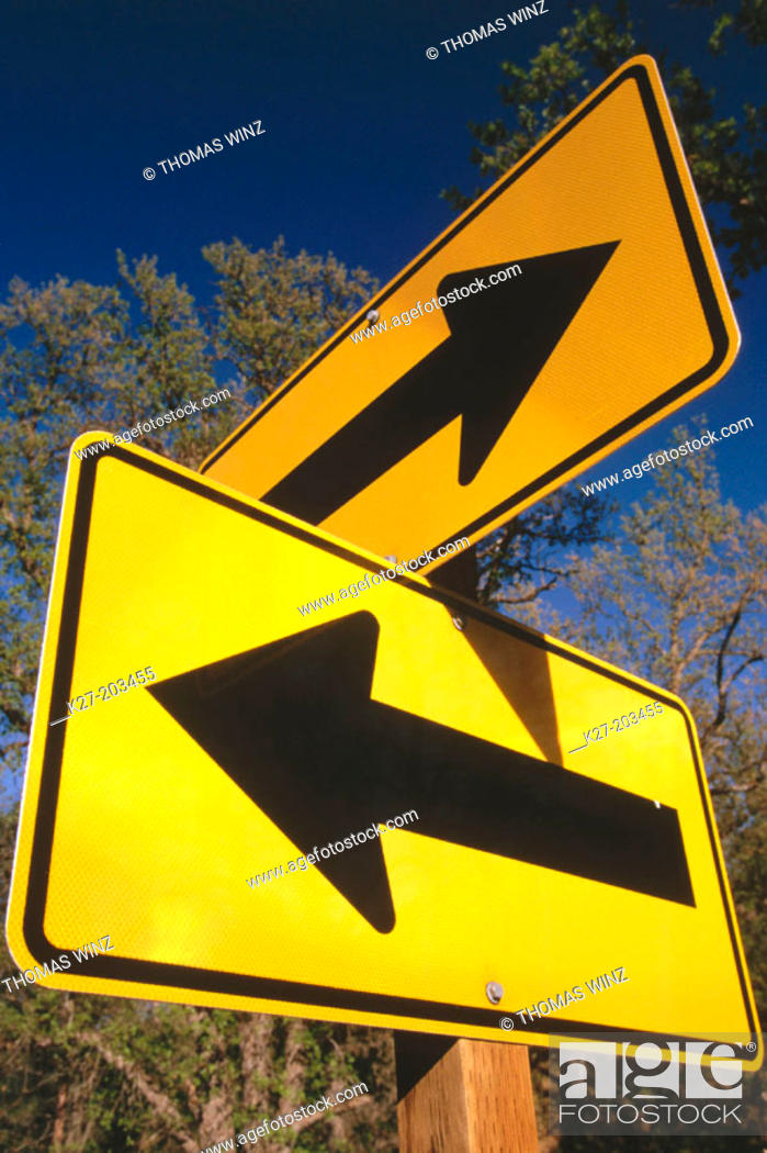 Stock Photo: Two arrows facing opposite direction. Northern California. USA.