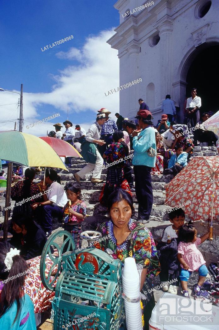 Stock Photo: Steps of Iglesia Santo Tomas. Sunday market. Woman with icecrusher offering drinks for sale. People.