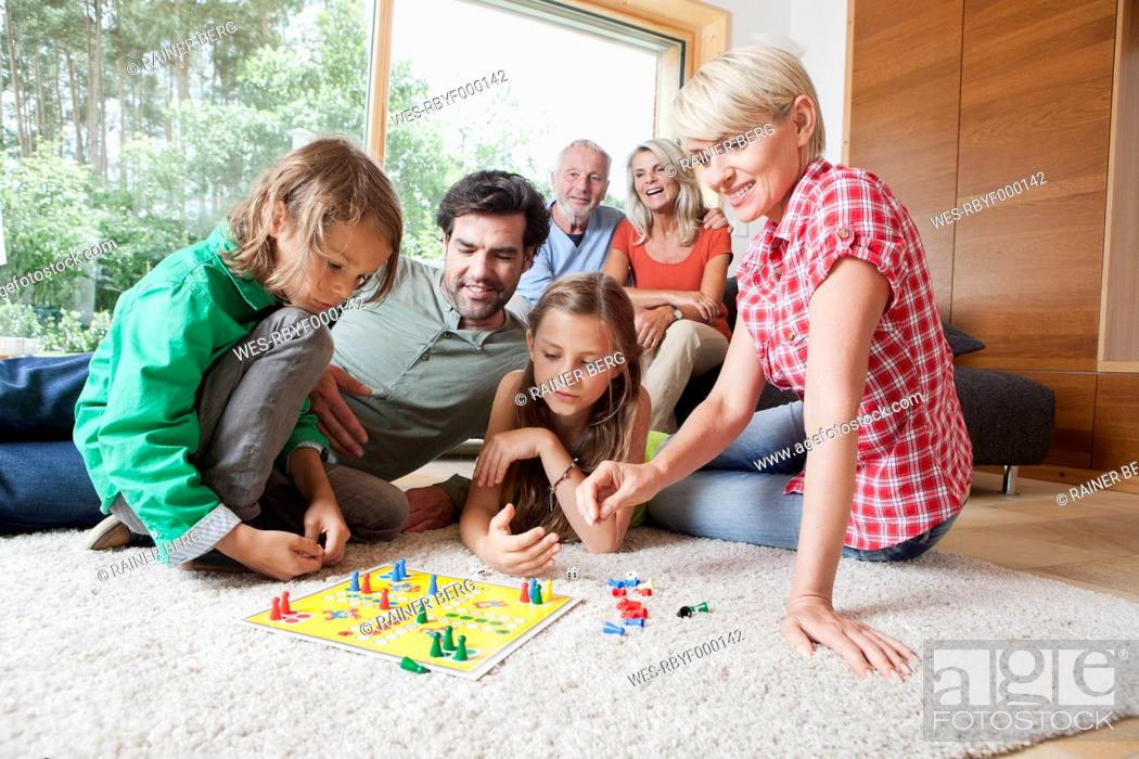 Stock Photo: Germany, Bavaria, Nuremberg, Family playing board game together.