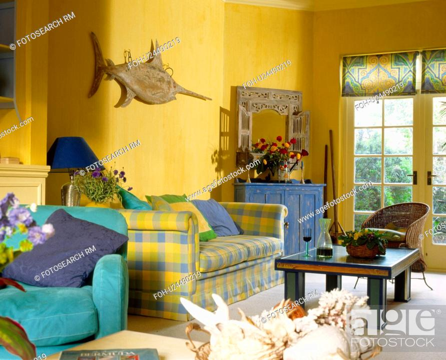 Turquoise Armchair And Yellow Checked Sofa In Bright Yellow
