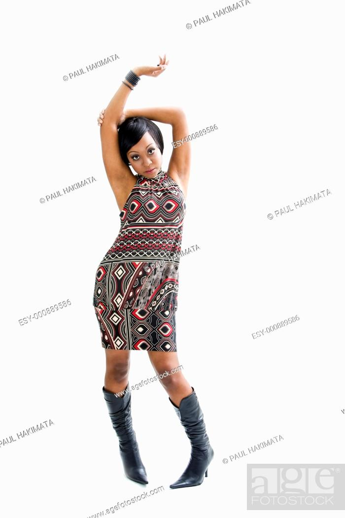 Stock Photo: Beautiful African woman in the seventies style standing and dancing with arm up above her head, isolated.