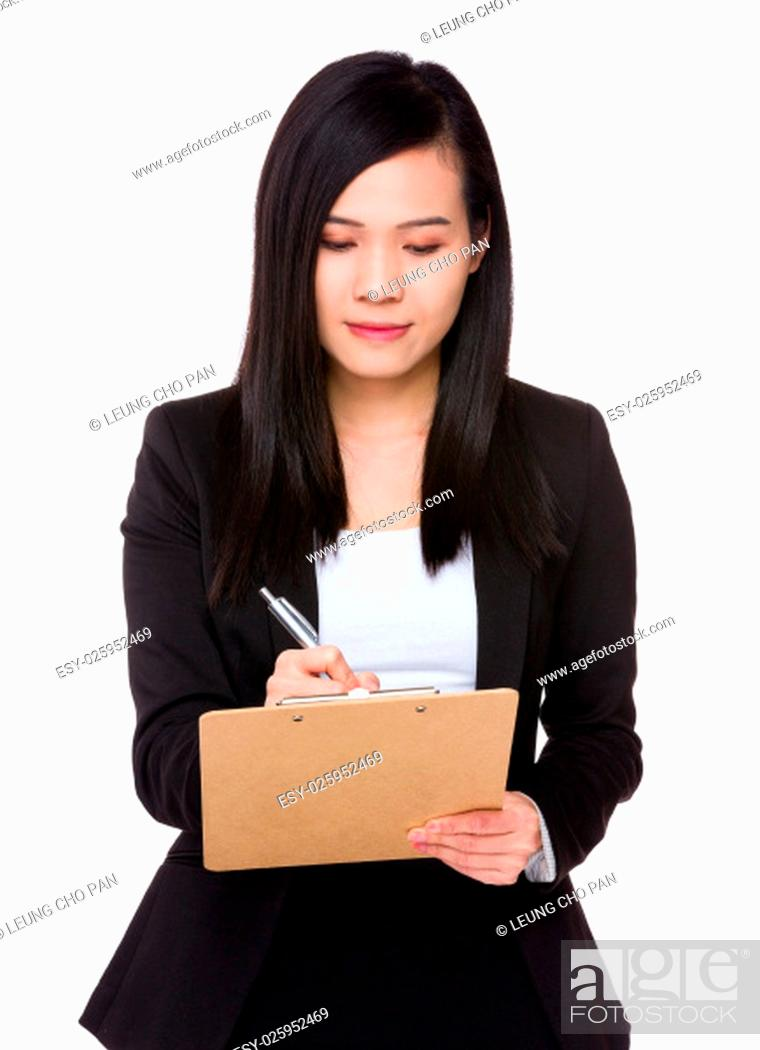 Stock Photo: Asian Businesswoman take note on clipboard.