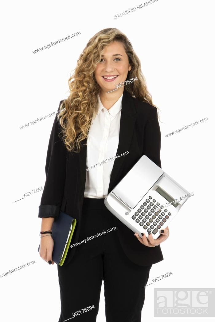 Stock Photo: Businesswoman standing in the studio with computer and cash register under her arms, she is wearing a black suit and white shirt.