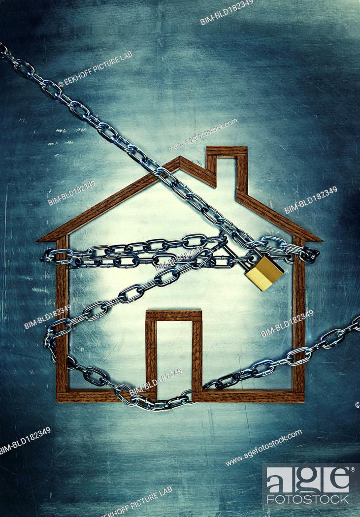 Photo de stock: House shape locked in chains.