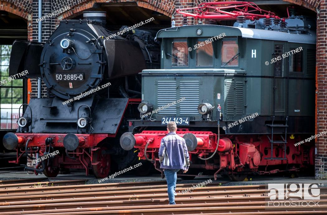 Stock Photo: 05.05.2018, Brandenburg, Wittenberge: Visitors are traveling in the railway museum Lokschuppen Wittenberge on the first day of the steam.