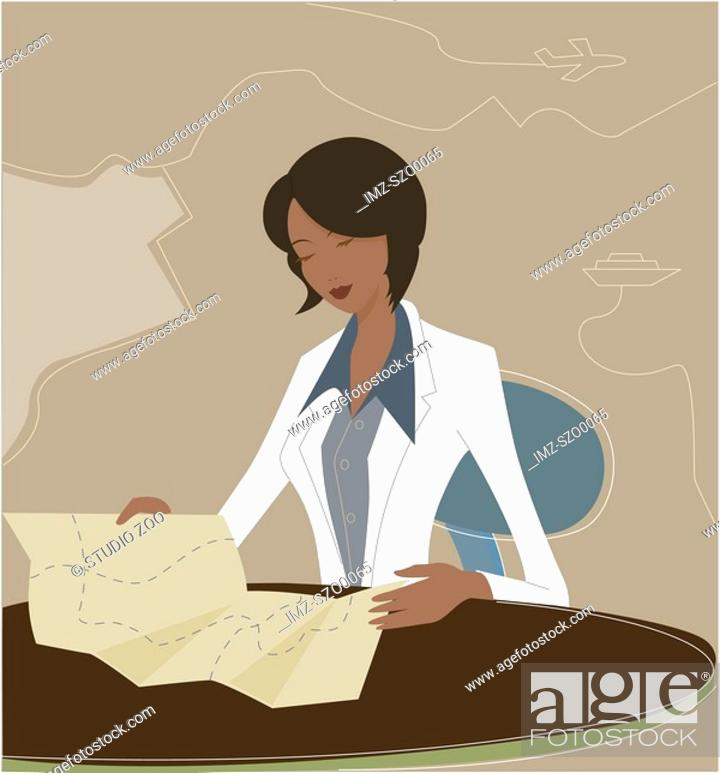Stock Photo: Businesswoman reading a map.