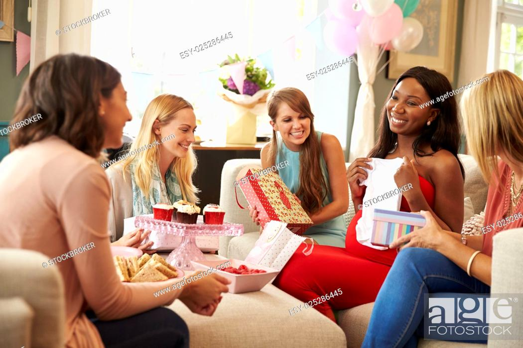Stock Photo: Group Of Female Friends Meeting For Baby Shower At Home.