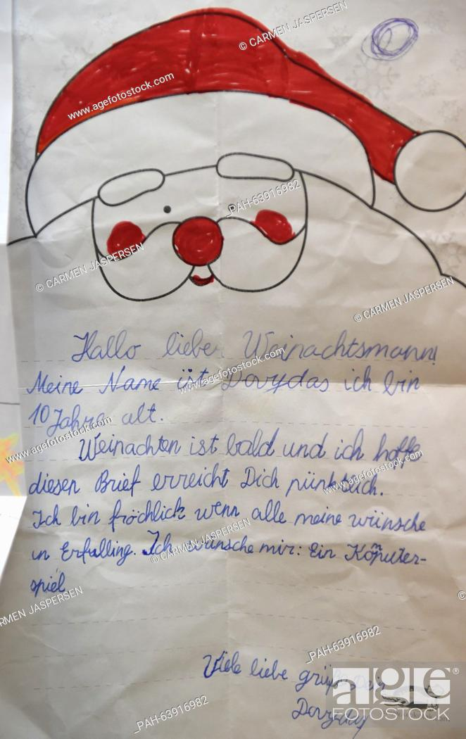 Stock Photo: A letter to Santa Claus seen in the Santa Claus office in Nikolausdorf (lit. Nicholas village), Germany, 24 November 2015.