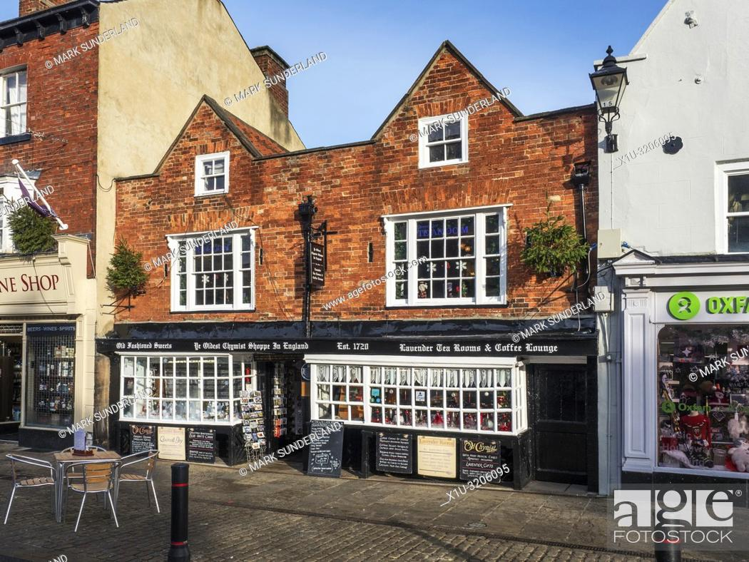 Stock Photo: The Oldest Chemist Shop in England and Lavender Tea Rooms Market Place Knaresborough North Yorkshire England.