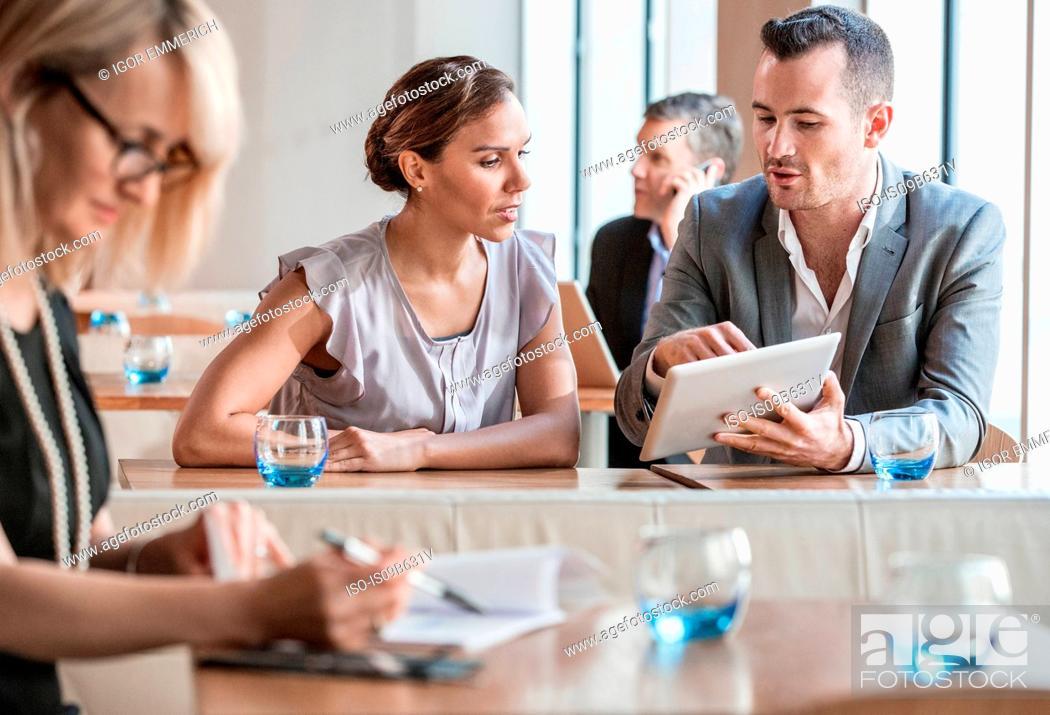 Stock Photo: Businessmen and businesswomen working.