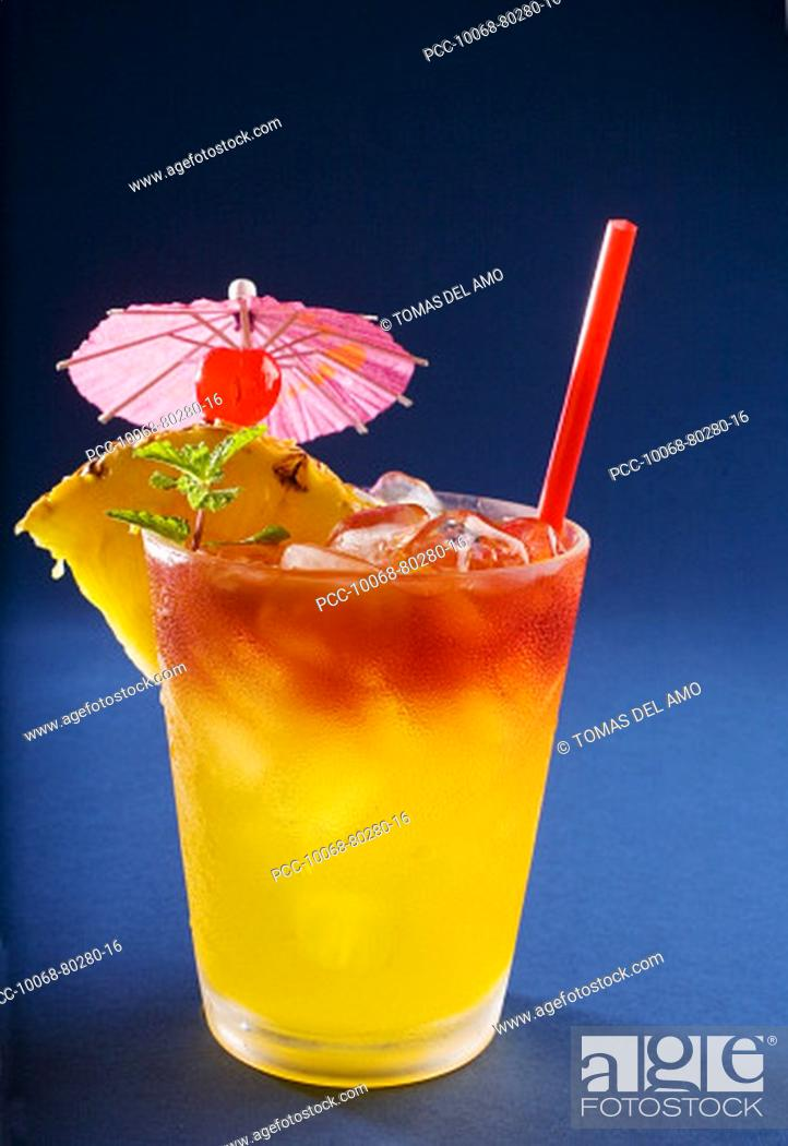 Stock Photo: A tropical drink garnished with fruit and flowers.