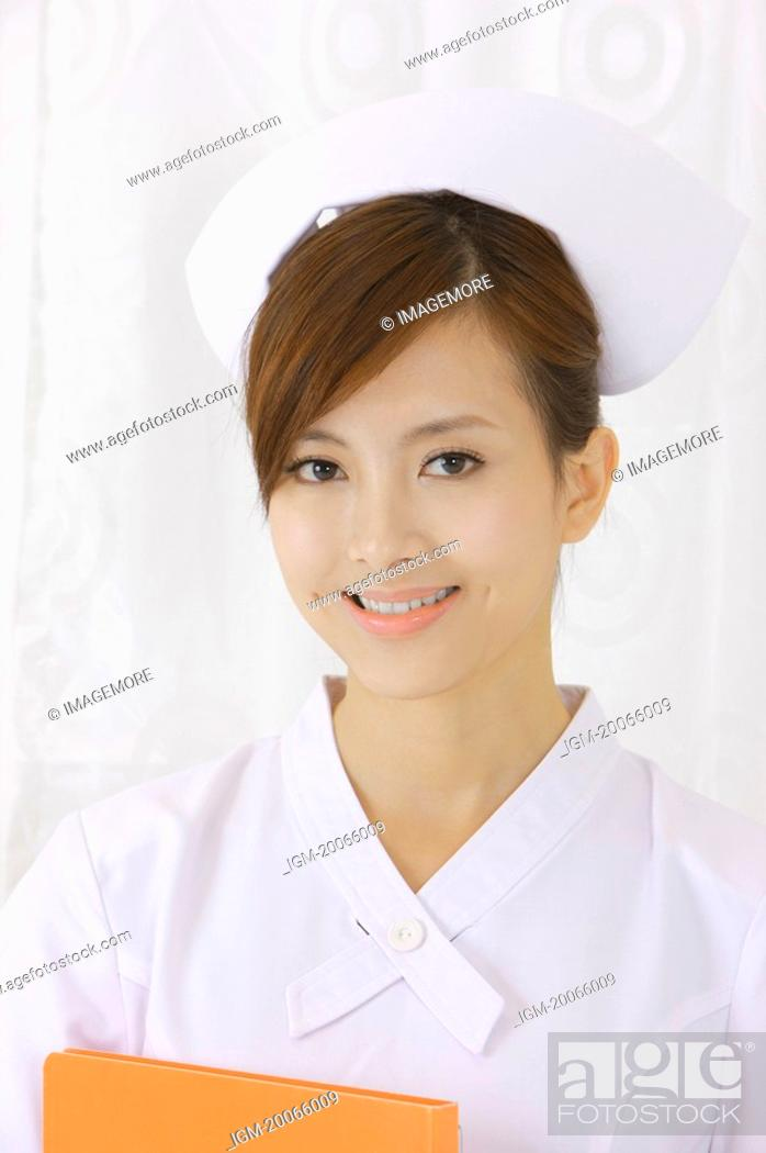 Stock Photo: Young nurse smiling at the camera.