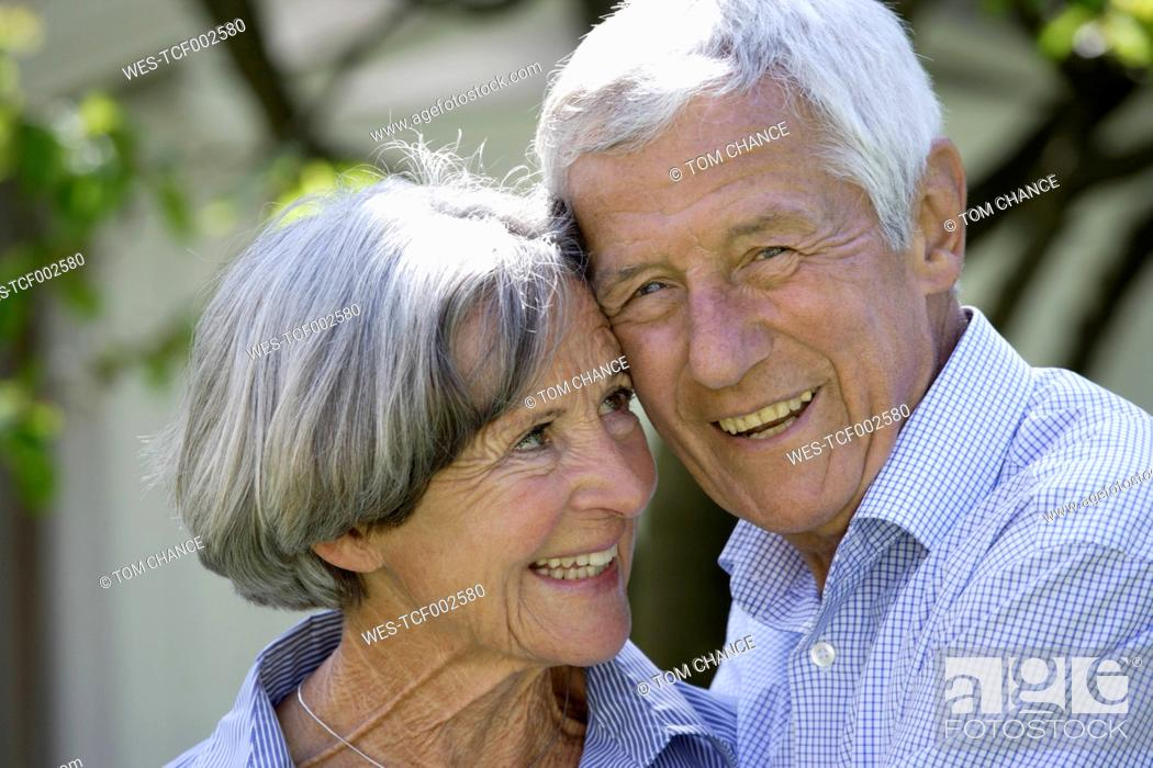 Stock Photo: Germany, Bavaria, Senior couple smiling, close up.