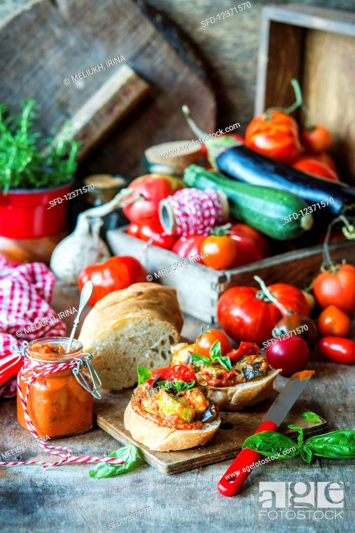 Stock Photo: Bread with tomato sauce and roasted vegetables.